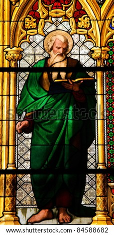 Church window in the Dom of Cologne, Germany, depicting Saint Matthew the Evangelist. - stock photo