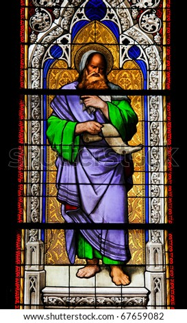 Church window in the Dom of Cologne, Germany, depicting the prophet Isaiah. - stock photo