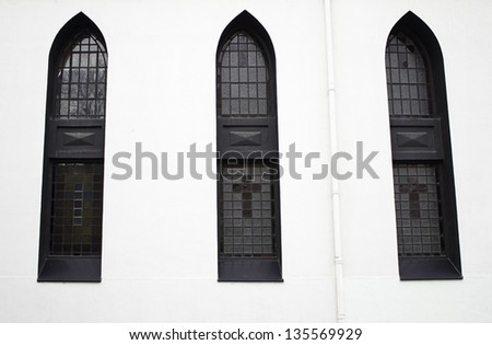 Church windows symbolic black crosses, religious and artistic decorations - stock photo