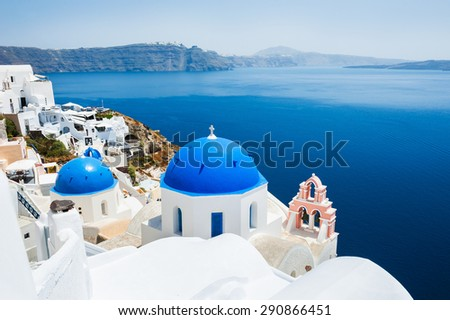 Church with blue domes in Oia town, Santorini island, Greece - stock photo