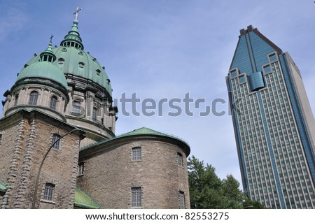 Church With Modern Montreal In The Backdrop (Canada) - stock photo