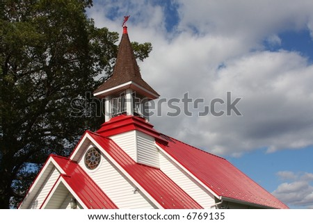 Church with red roof. - stock photo
