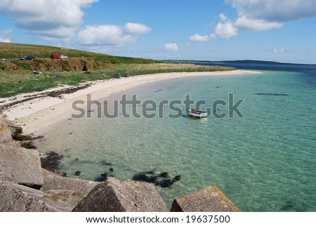 Churchill Barriers and a beautiful Beach on the Orkney Islands - stock photo