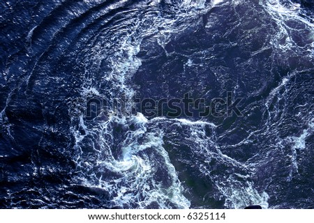 Churning water in the Caribbean ocean behind a cruise ship off the coast of Grand Cayman - see more in portfolio - stock photo