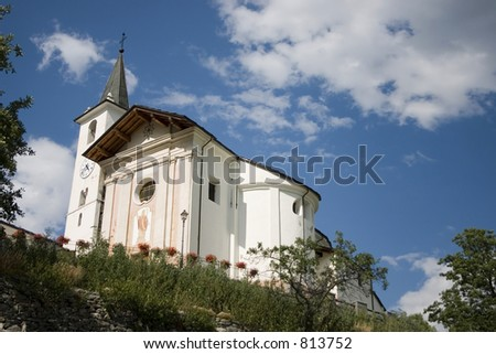 Churrch of Doues against the blue sky (Aosta region, Italy)