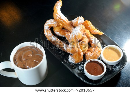churros chocolate, a typical Spanish sweet snack - stock photo