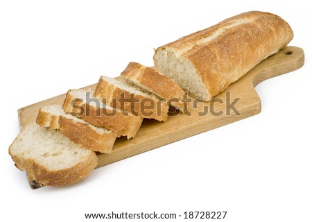 Ciabatta bread cut into pieces on chopping board isolated on white. Clipping path incl.