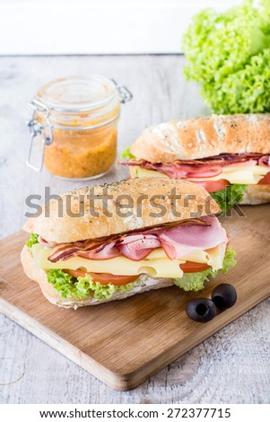 Ciabatta sandwichs with bacon and cheese on wooden boarde,selective focus - stock photo