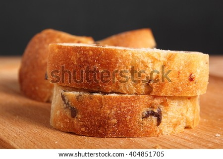 Ciabatta with black olives. Italian white bread.