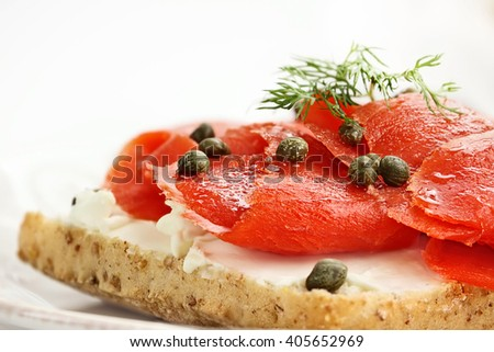Ciabatta with Salmon, Cream Cheese and Capers. Extreme shallow depth of field with selective focus. - stock photo