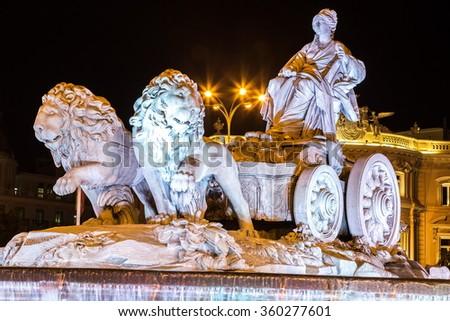 Cibeles fountain at Plaza de Cibeles in Madrid in a beautiful summer night, Spain - stock photo