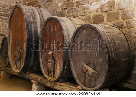 cider or wine barells in a basement  - stock photo