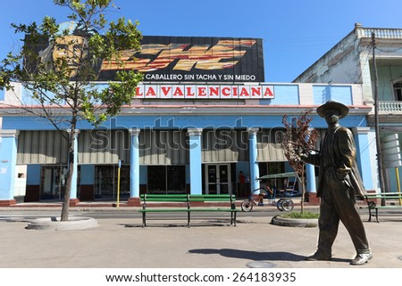 CIENFUEGOS, CUBA - FEBRUARY 7: Bronze statue of Benny More and Guevara billboard, Paseo del Prado on February 7, 2015 in Cienfuegos. . Moré was a master of most genres of cuban music.