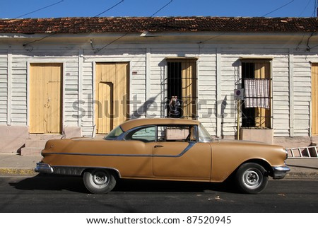 CIENFUEGOS, CUBA - FEBRUARY 3: Classic American car parked in the street on February 3, 2011 in Cienfuegos, Cuba. The multitude of oldtimer cars in Cuba is its major tourism attraction. - stock photo