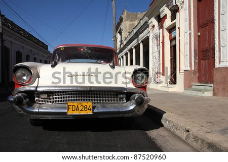 CIENFUEGOS, CUBA - FEBRUARY 3: Classic American Chevrolet car parked in the street on February 3, 2011 in Cienfuegos, Cuba. The multitude of oldtimer cars in Cuba is its major tourism attraction. - stock photo
