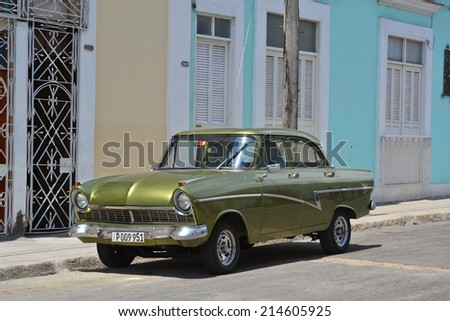 Cienfuegos - July 24: a green classic Ford car parked in a street in Cienfuegos, Cuba on July 24, 2014. Many classic cars continue to be maintained and privately owned by Cubans.  - stock photo