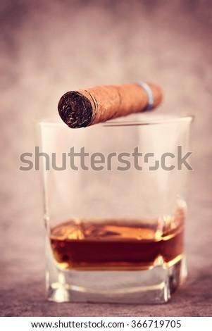 Cigar and Cognac. Cuba cigar and cognac. Cigar still life.  - stock photo