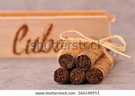 Cigar. Cigars and wooden box, closeup. Cuba cigars.  - stock photo