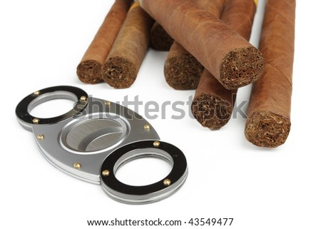 Cigar guillotine and cigars isolated on white background - stock photo