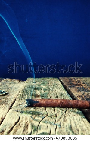 Cigar on a wooden table.