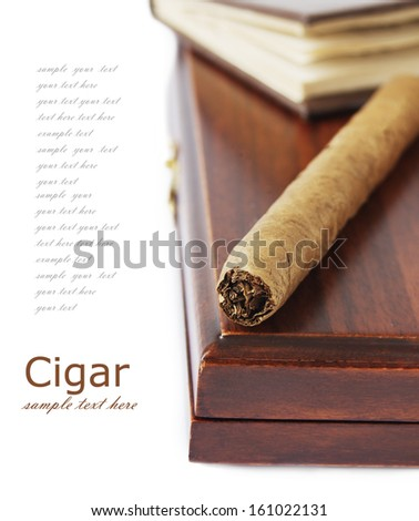 Cigar on luxury cigar box and book isolated on white background - stock photo
