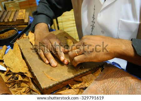 Cigar rolling - stock photo