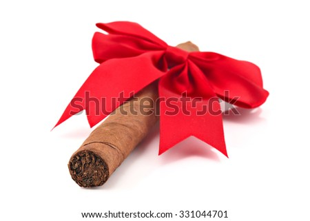 Cigar with christmas ribbon isolated on white, shallow focus - stock photo