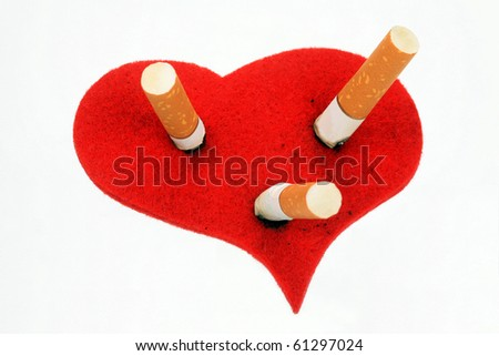 Cigaret stubs in heart on a white background