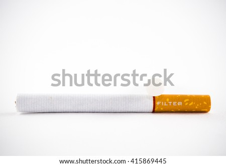Cigarette and filter isolated on a white background