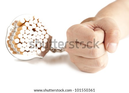 Cigarette  and  handcuffs  isolateed on white - stock photo