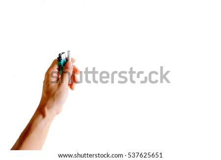 Cigarette and lighter in hand