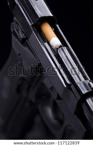 cigarette burned like a bullet in the barrel of a gun - stock photo