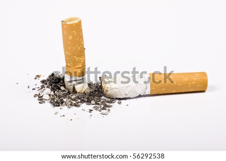 Cigarette butt and ash macro closeup, isolated