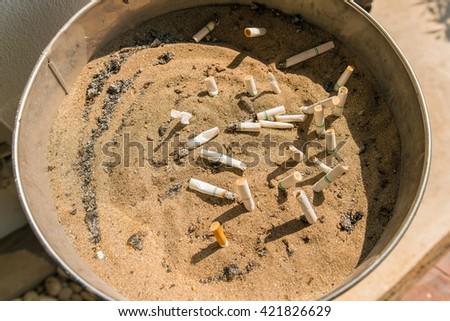cigarette butt ; cigarette on Ashtray with cigarette stubs - stock photo