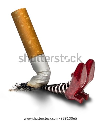 cigarette butt on the wicket witch - stock photo