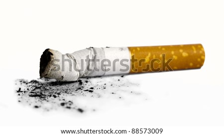 Cigarette butt with ash over white background - stock photo