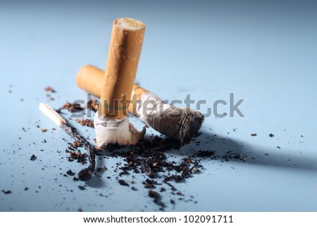 Cigarette butts and ash, close-up