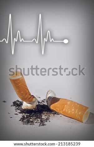 Cigarette butts and heartbeat line expressing health hazard - Anti smoking concept - stock photo