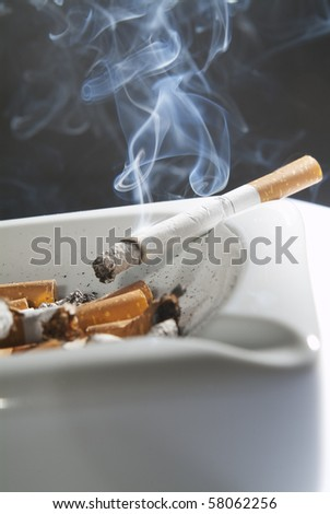 Cigarette butts in an ashtray - stock photo