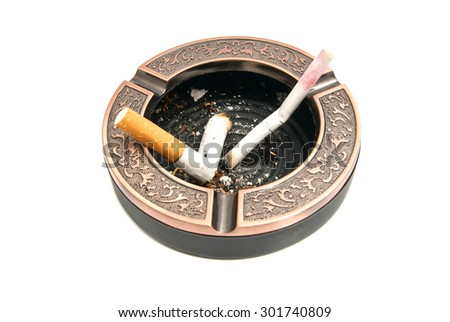 cigarette butts in metal ashtray on white - stock photo