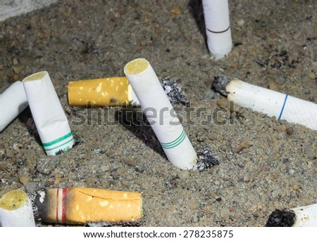 Cigarette butts in the ashtray dirty - stock photo