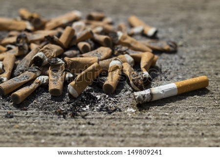 Cigarette butts. Large number of cigarette butts, close-up - stock photo