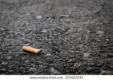 Cigarette butts on the street - stock photo