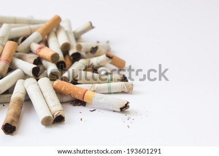 Cigarette Butts With White Background For Text - stock photo