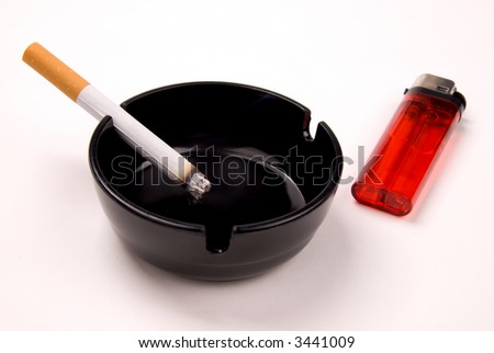 cigarette in a black ashtray with a red lighter isolated over a white background