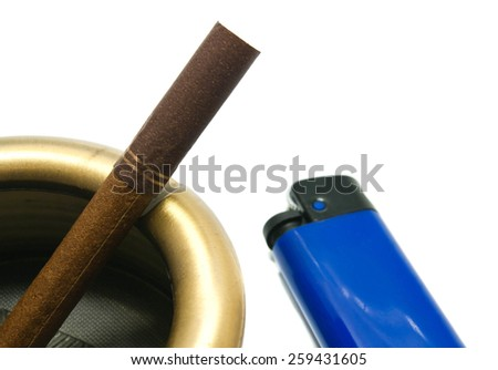 cigarette in ashtray and lighter on white closeup - stock photo