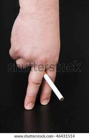 cigarette in fingers - stock photo