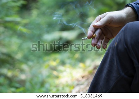 Cigarette in hand