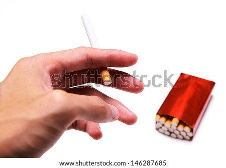 Cigarette in hand isolated on a white background - stock photo