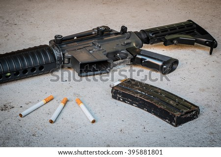 cigarette in Magazine gun.Customizable dark tones.Indicate smoking kill you like a gunshot. - stock photo